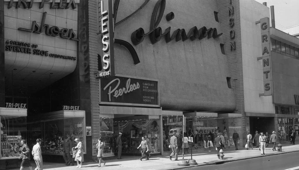 Robinson department store at 1020 Market in 1961 (at left) and today. Turns out that the peculiar, sweeping, now-blank-faced wall there was designed by Victor Gruen as a backdrop for the store´s looping logo.