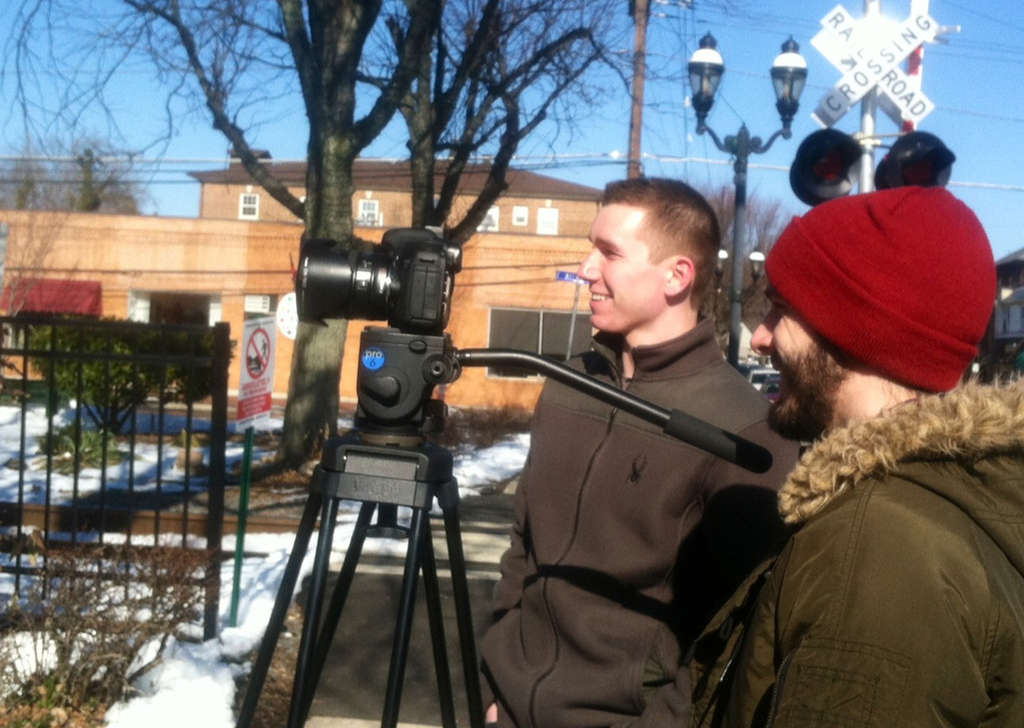 Mark VanZevenbergen (left) and Matt Torres, who are making a documentary on the 1995 Haddon Heights shooting that took the lives of two law enforcement officers, film scenes along Station Avenue.