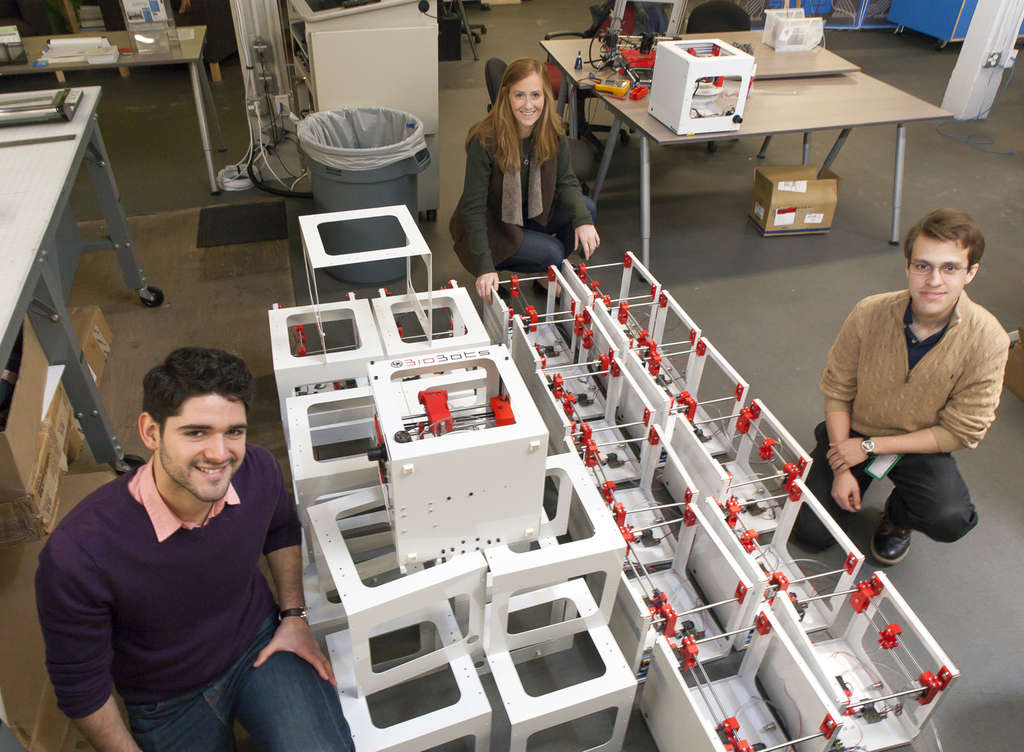 BioBots cofounders Danny Cabrera (left) and Ricardo Solorzano, and operations chief Madeline Winter assemble a high-resolution 3D printer.