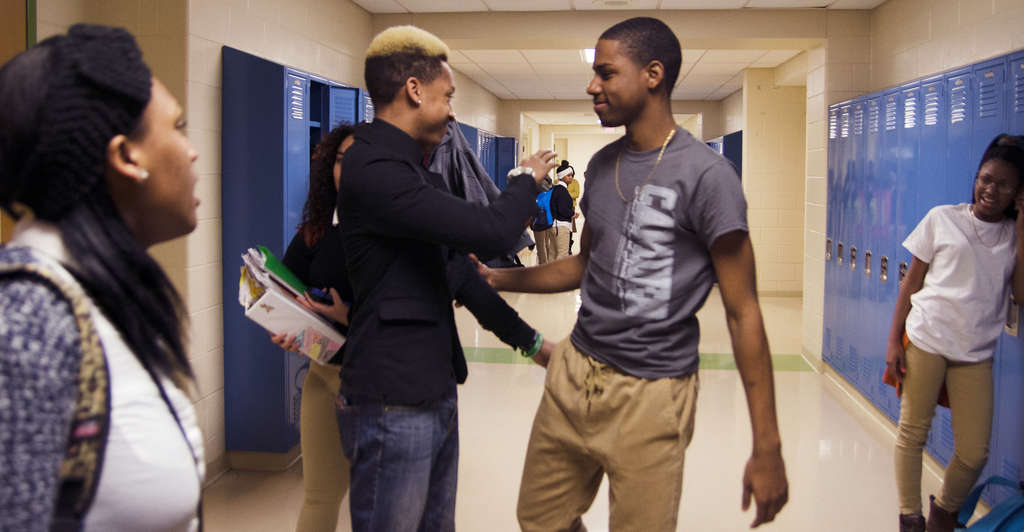 "Ta´Quan Allen (second from left) greets a friend at his Camden alma mater. He wrote, directed, and stars in the short film ""Wake Me Up."""