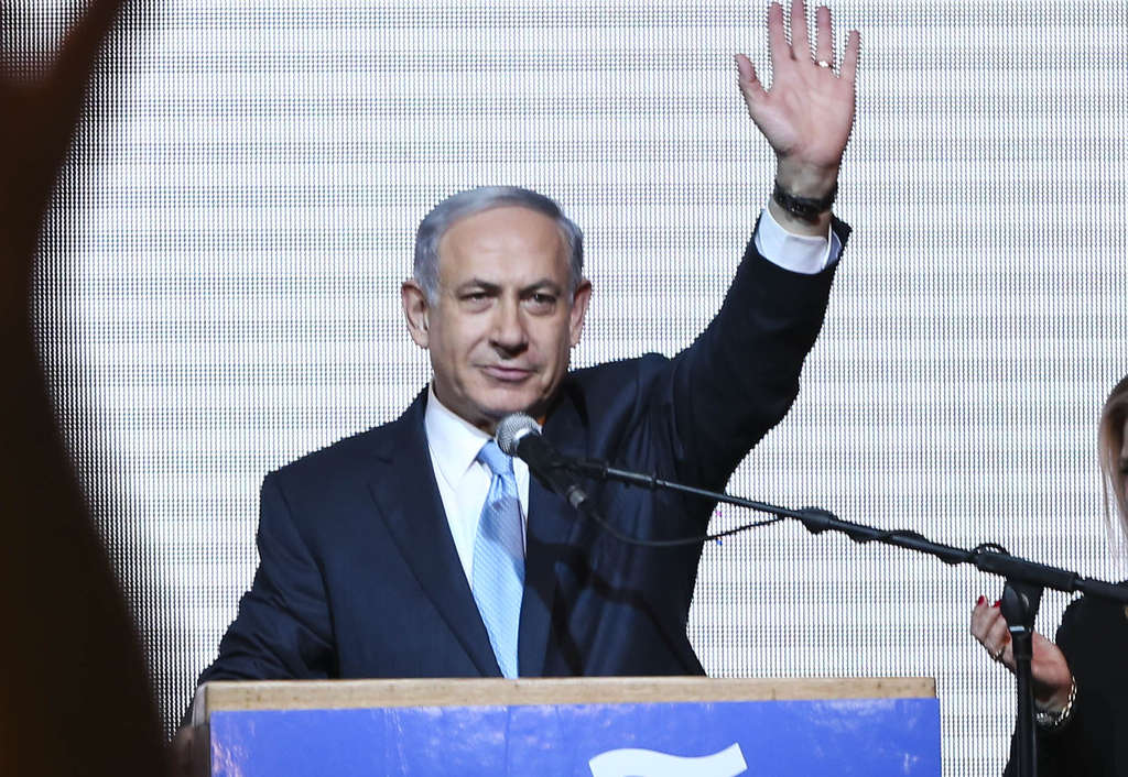 Benjamin Netanyahu greets supporters Tuesday night.