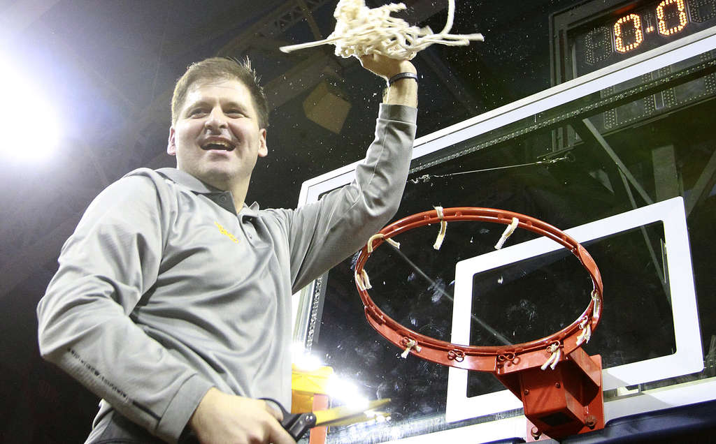 "Roman coach Chris McNesby, celebrating the PCL title Feb. 23, now can add a state trophy. ""It´s very satisfying,"" he said of winning the state championship. CHARLES FOX / Staff"