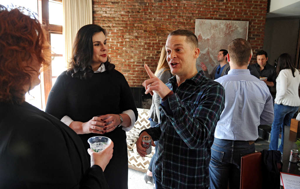 "Kim Otto (left) and Jay Lassiter co-host a brunch at Lassiter´s house in Cherry Hill. ""We´re trying to figure out how to leverage this historic visit,"" Jay Lassiter said."