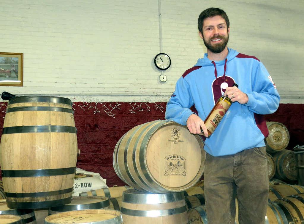 "James Yoakum, owner of Cooper River Distilling in Camden, pulls a sample of his ""IPA-skey"" distilled beer."