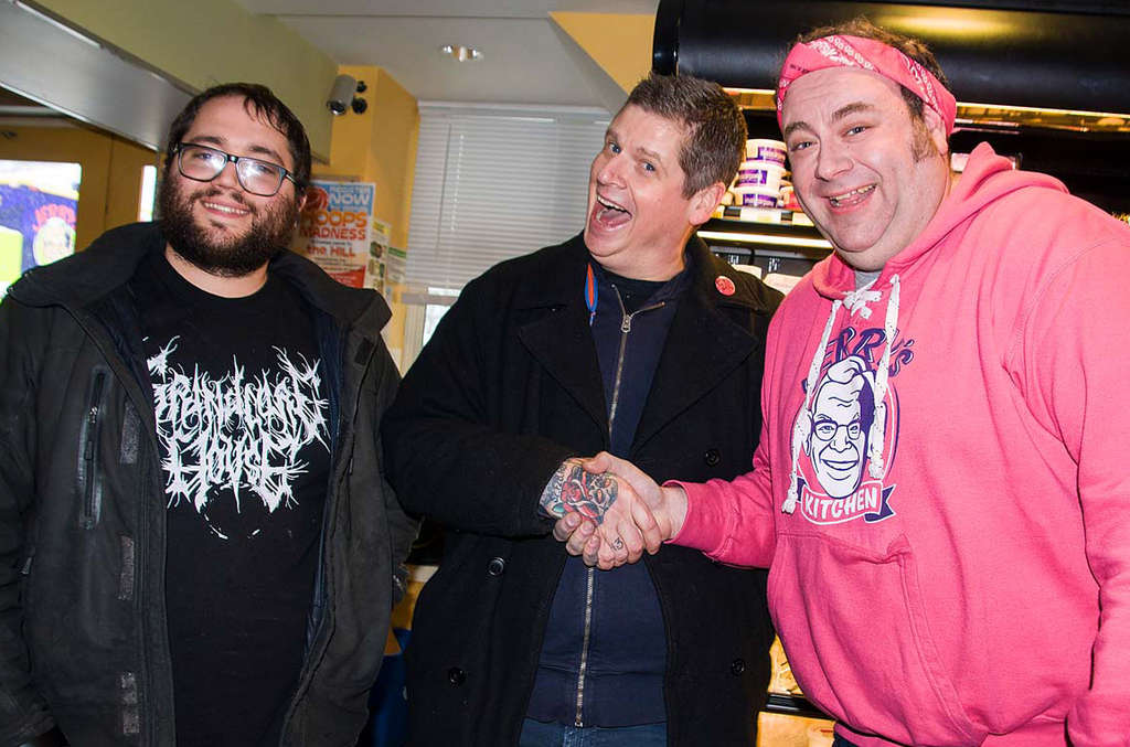 Winner Mark McKinney (center), of Royal Tavern, receives the kudos of competitors Mark Mebus (left), of Blackbird Pizzeria (who made McKinney´s seitan), and Scott Kaplan, of Jerry´s Kitchen.