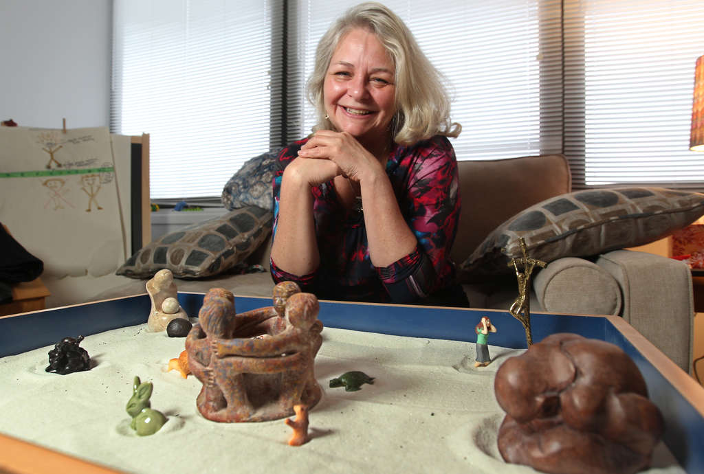 "Cherry Hill therapist Carolyn Piro with her sand-tray diorama: ""The subconscious always comes out in the tray."""