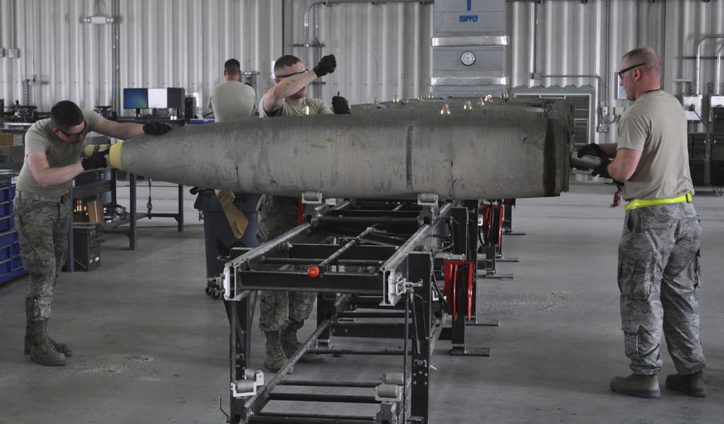 A U.S. Air Force munitions team assembles guided bombs to support airstrikes on the Islamic State.