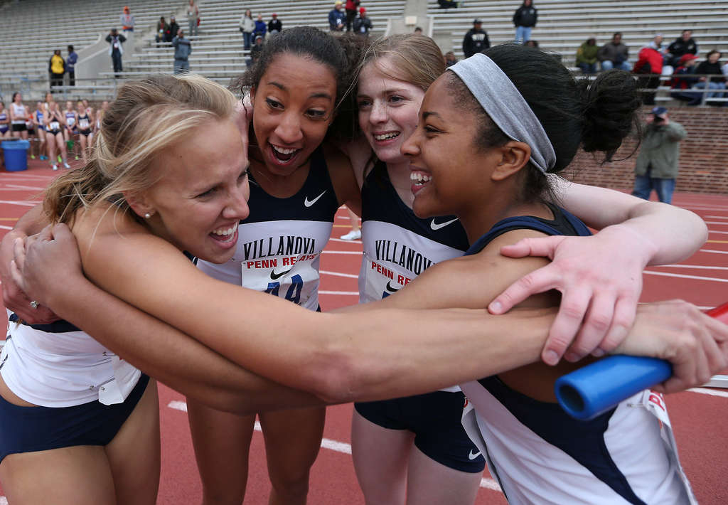 Stephanie Schappert (left) huddles with teammates (from left) Angel Piccirillo, Siofra Cleirigh Buttner, and Michaela Wilkins after their win for Villanova in the distance-medley relay.