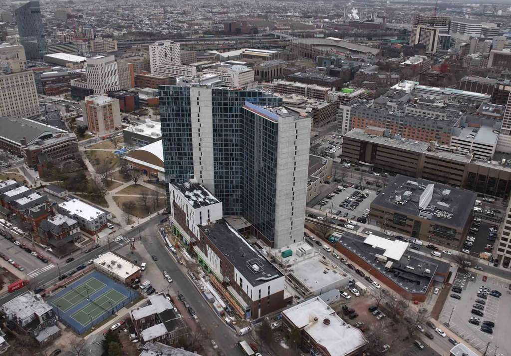 This is Drexel University's new, 24-story dorm called The Summit, at 34th and Lancaster. It will open in Septemer 2015 with 1,316 beds. It is located two blocks from the row of intact Victorian buildings that a developer wants to turn into private dorms.