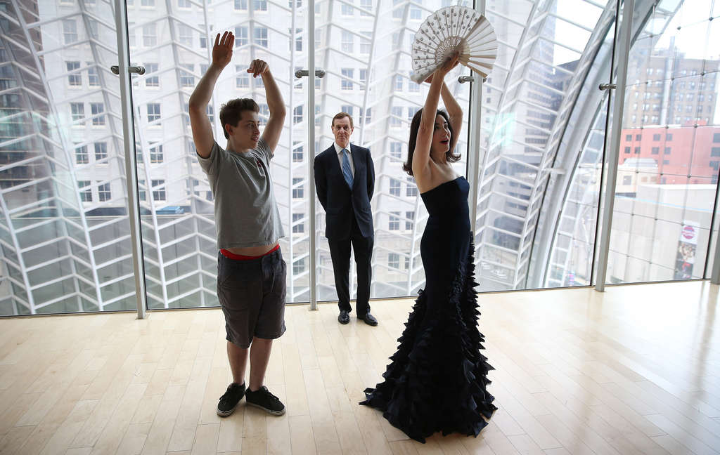 Catherine Clifton receives dance tips from David Rubio (left), a student at the High School for Creative and Performing Arts as her husband, Anthony, watches on the garden roof at the Kimmel Center. The Cliftons created an award for young artists; Rubio is a recipient.