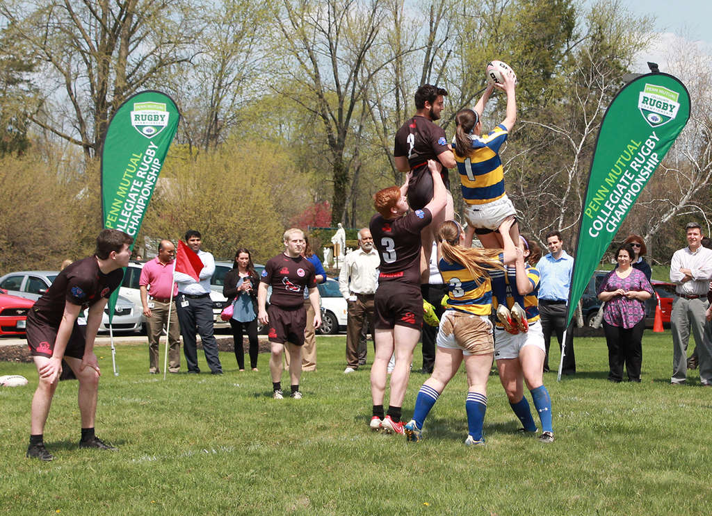 Members of the University of Delaware women´s team and the St. Joseph´s men´s team demonstrate rugby exercises at an exhibition at the headquarters in Horsham. Penn Mutual