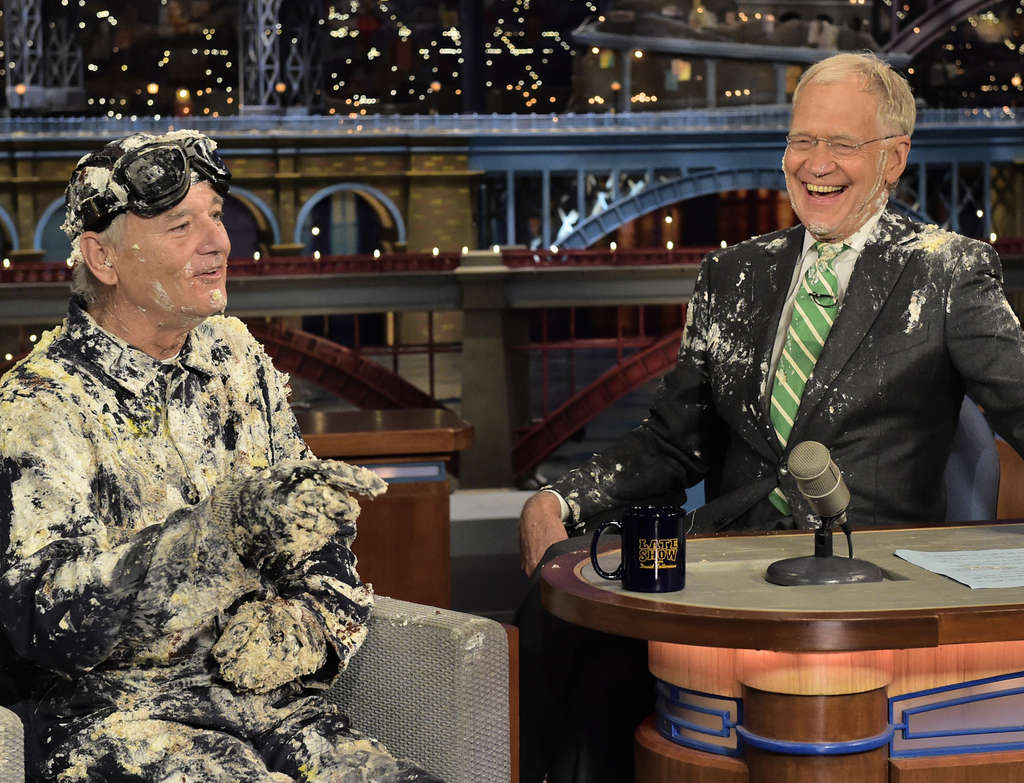 JOHN PAUL FILO / CBS VIA AP Bill Murray , first guest on David Letterman´s very first show, jumped out of a cake Tuesday night to say farewell.