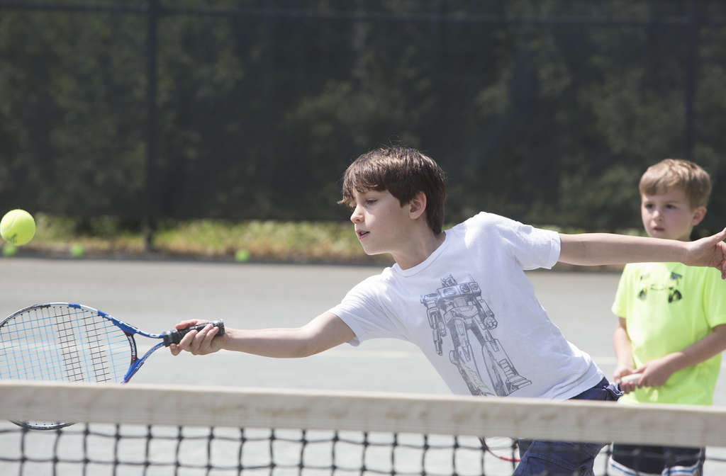 The Green Valley Tennis Club in Westmont opened in 1977. During an open house last weekend, Alexander Lawrie, 8, stretched for a forehand on one of its Har-Tru courts.