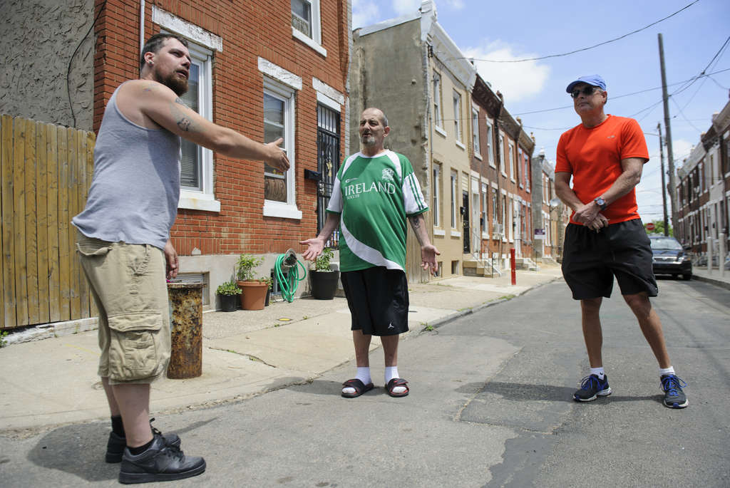MICHAEL PRONZATO / STAFF PHOTOGRAPHER Andrew McDermott squabbles with Bobby McDermott and Ian Griffith about home values on Martha Street.