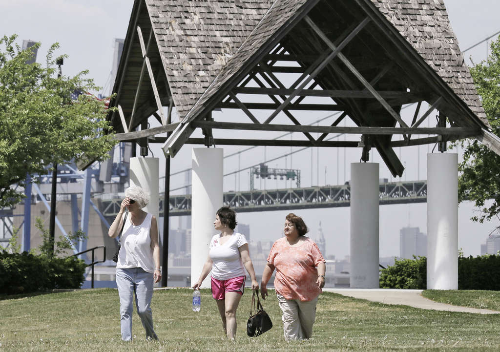 (From left) Patricia Marie Sims, Kelly Ann Sauer, and Mary Lou Adams spent time at Proprietors Park and handing out festival fliers.