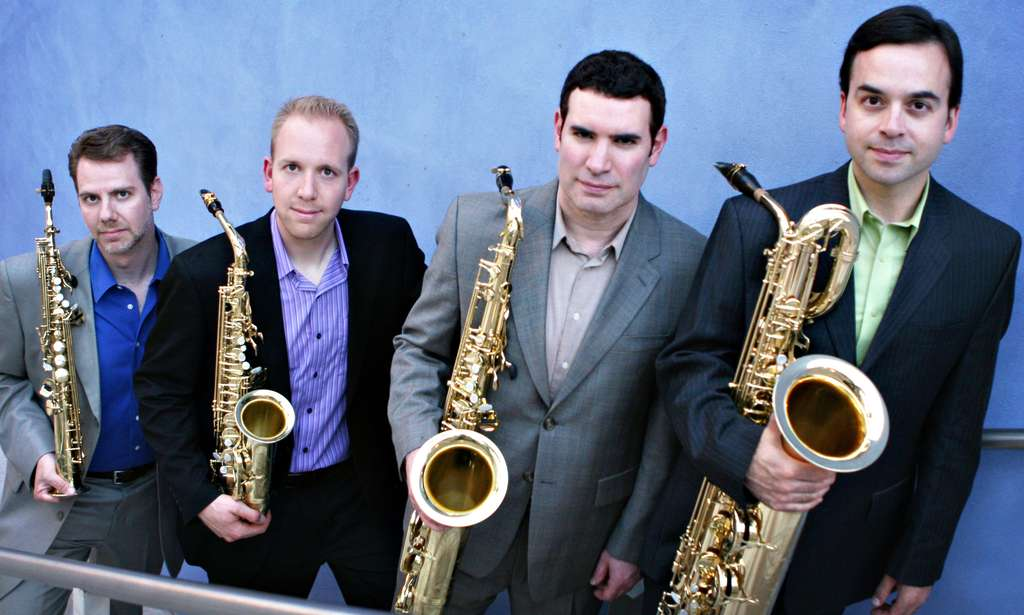 The Prism Quartet presented the program. From left: Timothy McAllister on soprano saxophone, Zachary Shemon on alto, Matthew Levy on tenor, and Taimur Sullivan on baritone.