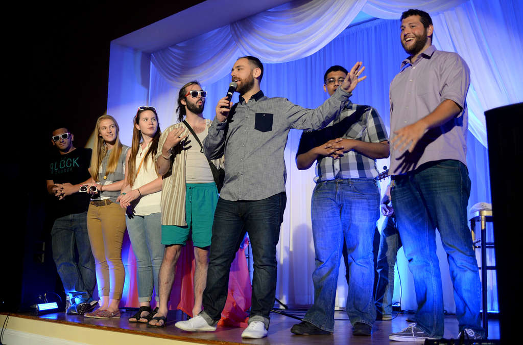 Founding and lead pastor Joey Furjanic (center), of the Block Church, recognizes the Port Richmond church´s summer interns. ( TOM GRALISH / Staff Photographer )
