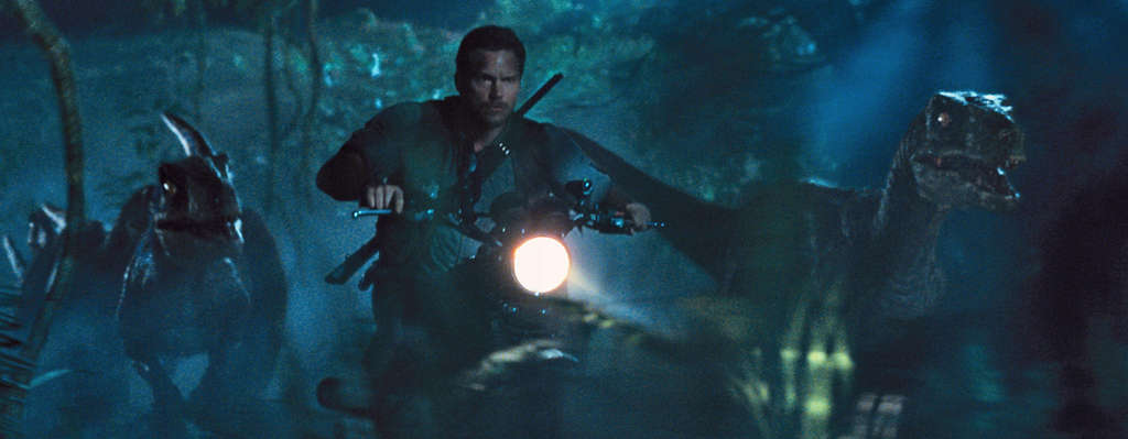 "A man and his dinos: Chris Pratt as a trainer with velociraptors in ""Jurassic World."""