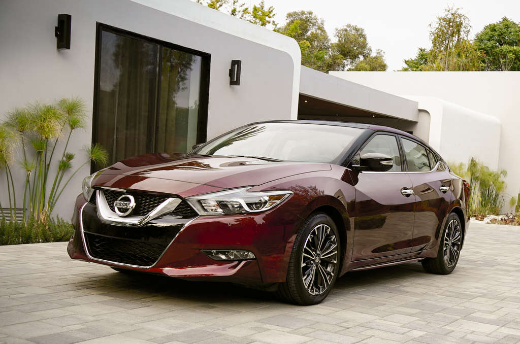 The 2016 Maxima, the eighth incarnation of the largest Nissan sedan. It has raised front fenders and a long hood.