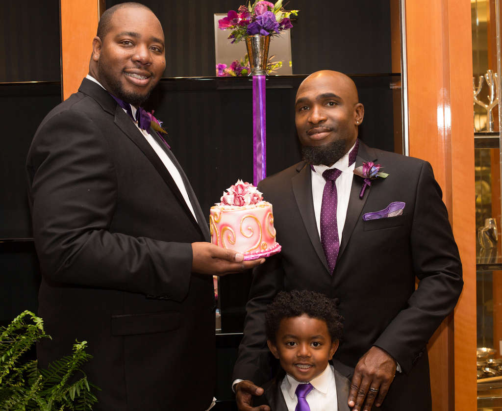 Jason Strong (left) and Anthony Henderson with their son, Marcelino. They were married in a Los Angeles-area Macy´s.