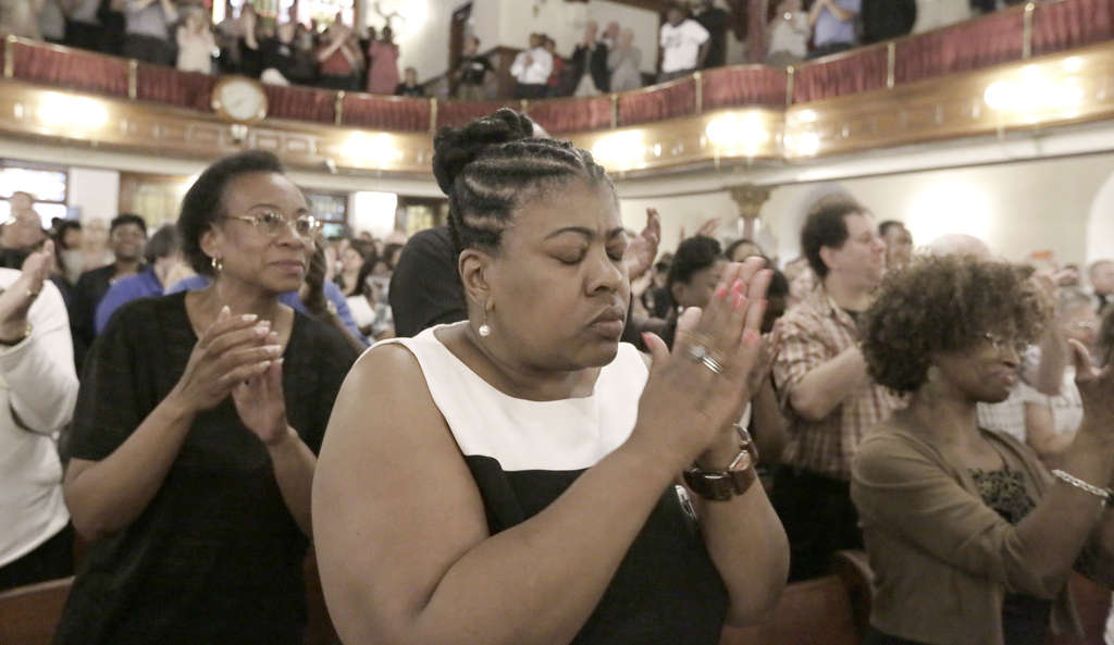 ELIZABETH ROBERTSON / STAFF PHOTOGRAPHER Dr. Cassandra Gould , pastor at the Quinn Chapel AME Church in Jefferson City, Mo., attends a prayer vigil and service yesterday in Philadelphia.