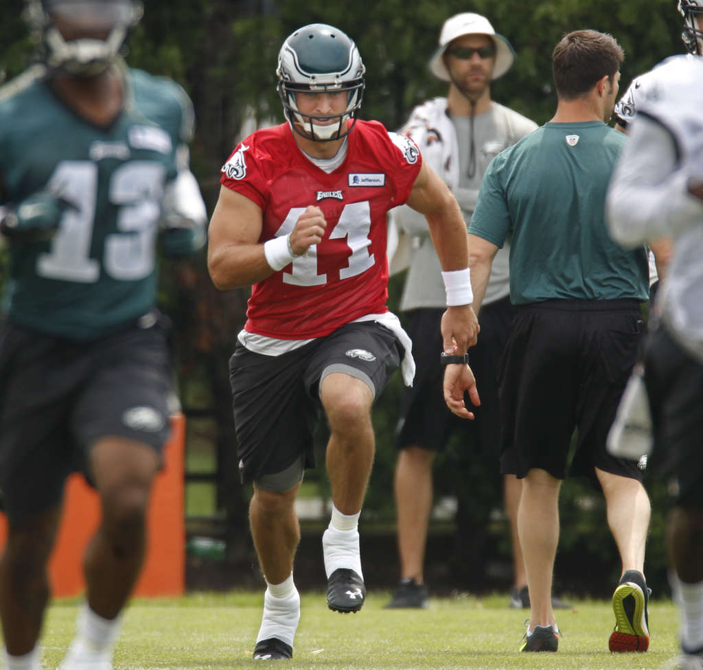 MICHAEL BRYANT / STAFF PHOTOGRAPHER Eagles´ Tim Tebow is working hard to improve.