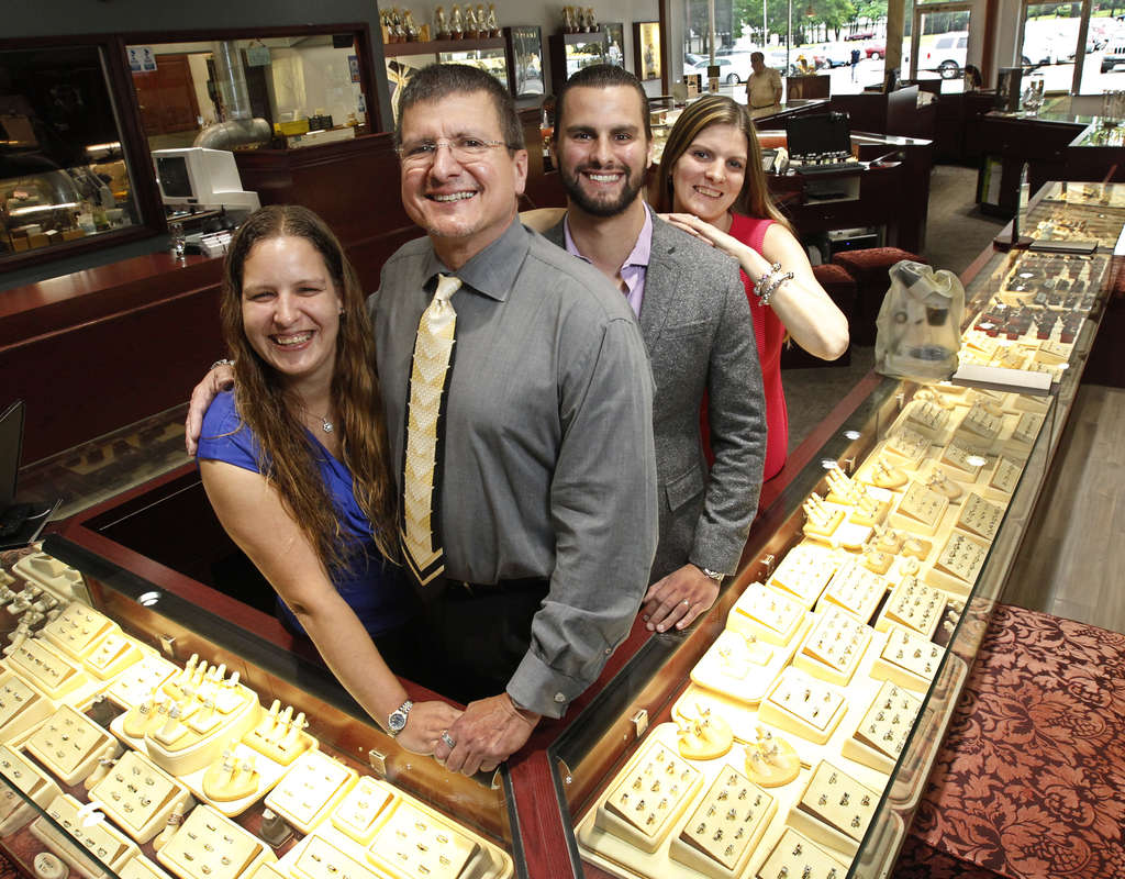Angelo Breaux at Family & Co. Jewelers on Route 70 with children Jessica (left), Angelo Jr., and Crystal Barket.