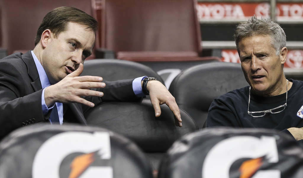 Sixers GM Sam Hinkie (left), with coach Brett Brown, no doubt will have more surprises on draft night. STEVEN M. FALK / Staff