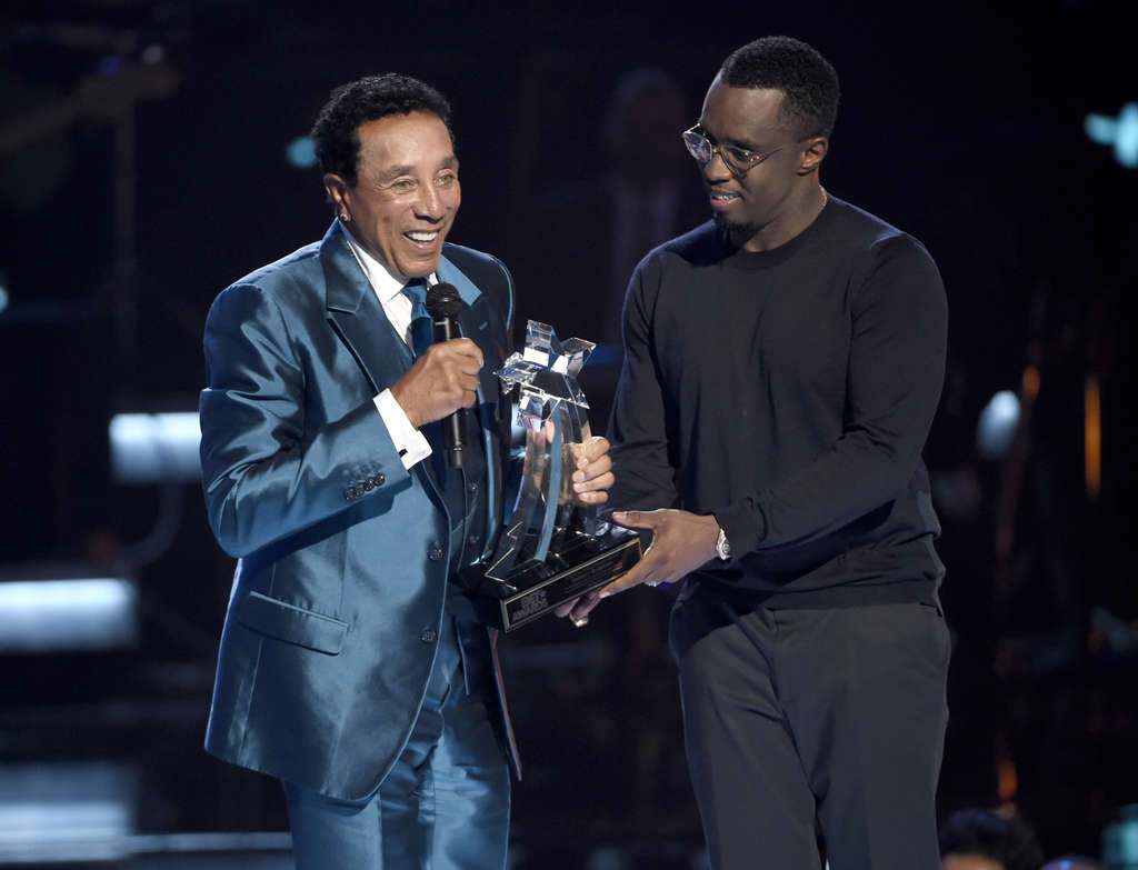 """Sean """"Diddy"""" Combs (right) presenting the lifetime achievement award to Motown singer Smokey Robinson at the BET Awards Sunday. Last month, Diddy was arrested by UCLA police after a fight with one of his son´s football coaches."""