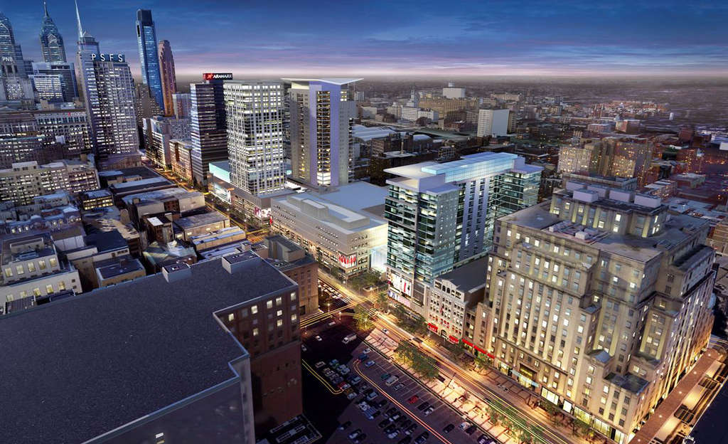 "Developers are exploring the idea of putting three towers on top of the former Gallery, soon to be called the ""Fashion Outlets of Philadelphia,"" starting with an apartment building at Ninth and Market Streets, right of center."