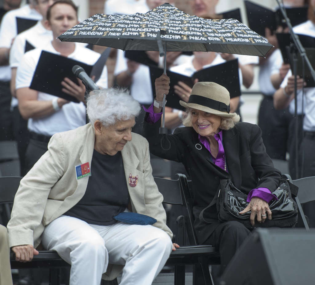 Edith Windsor (right), plaintiff in the Supreme Court case that nullified the Defense of Marriage Act, sharing her umbrella Saturday with Ada Bella, one of the 40 activists who marched in the first gay rights protest in 1965.