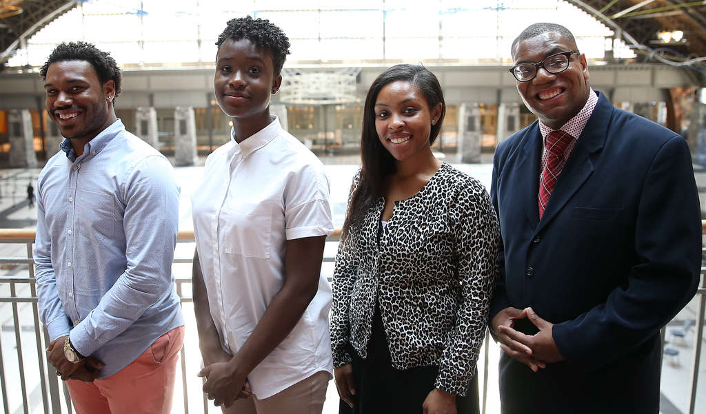DAVID MAIALETTI / STAFF PHOTOGRAPHER Young members of the NAACP (from left) DeVaun Brown, Danielle Roomes, Lauren Footman and Shawn Aleong.
