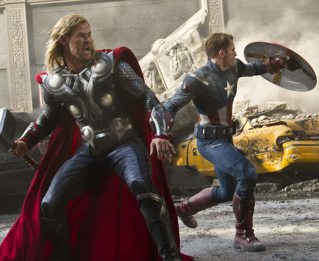 "Flexing box-office muscle, Chris Hemsworth (left) is Thor and Chris Evans is Captain America in 2012´s ""The Avengers."""