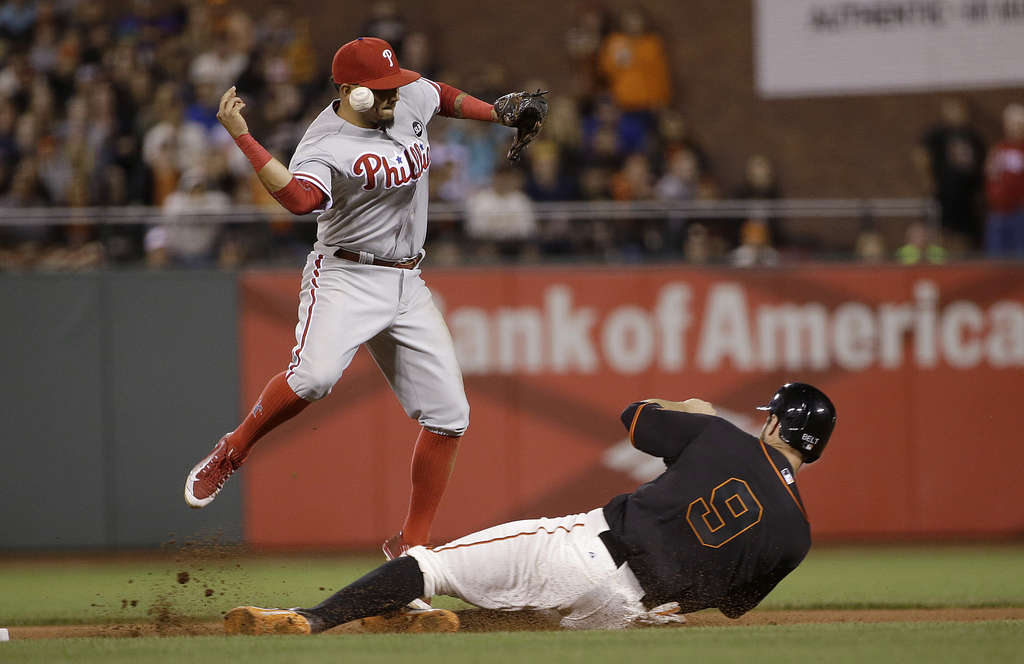Freddy Galvis bobbles the ball during a fielder´s choice against the Giants. Misplays like this one are part of the reason the Phillies have the worst record in baseball.