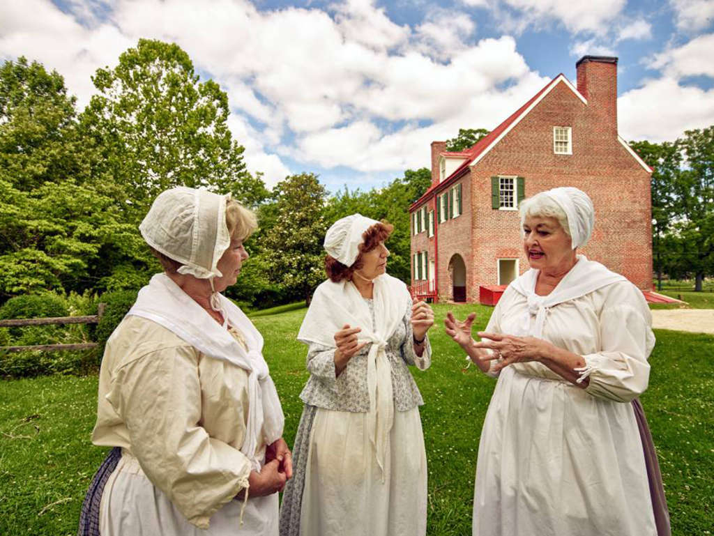 Barclay Farmstead volunteers (from left) Mary Maitico, Anna Marie Marino, and Peggy McDaniels were photographed outside the historic site. Highsmith is submitting her photos to the Library of Congress.