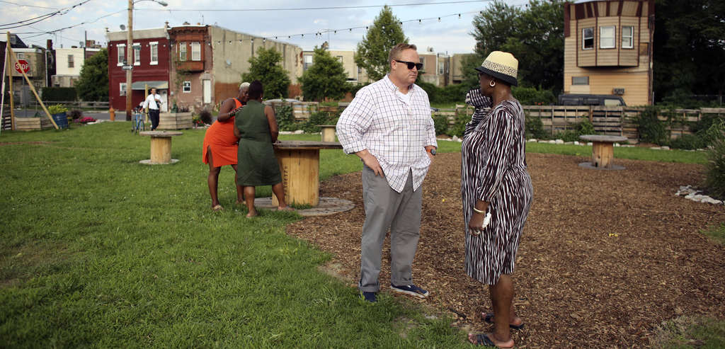 Pop-Up owner John Longacre with neighbor Florence Dixon at the beer garden in Point Breeze. Longacre is in compliance with the law, so what's with the L&I infractions?