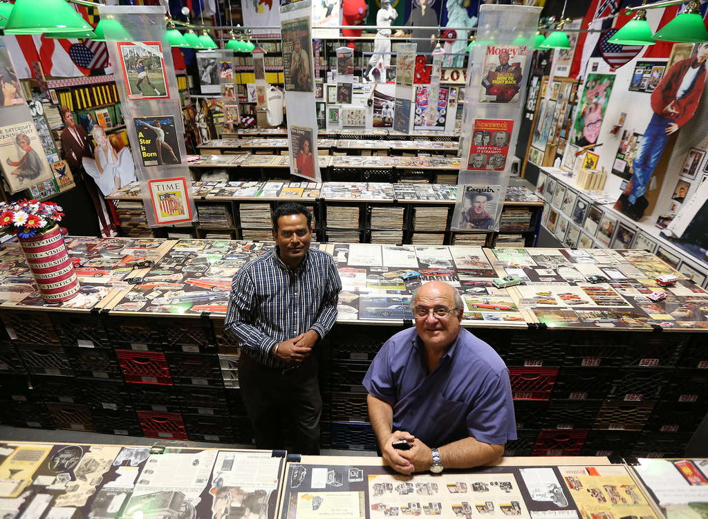 "Fran DiBacco (right) created a nostalgia and pop-culture exhibit in Paulsboro out of his collection of vintage magazines and ads, with help from Kamal Kishore (left). ""I turned a hobby into a business,"" he says."