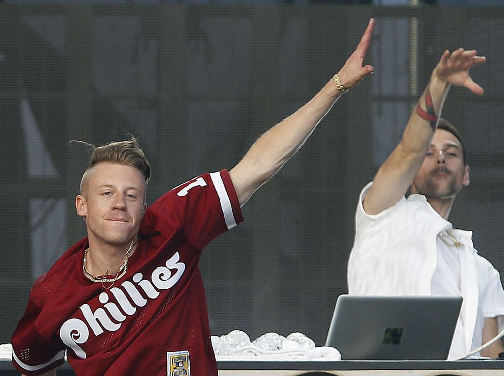 Macklemore, who performed with Ryan Lewis, right, at the 2013 Budweiser Made in America festival on the Parkway, struggled with the stresses of success last year, but his fiancee helped get him back on track.
