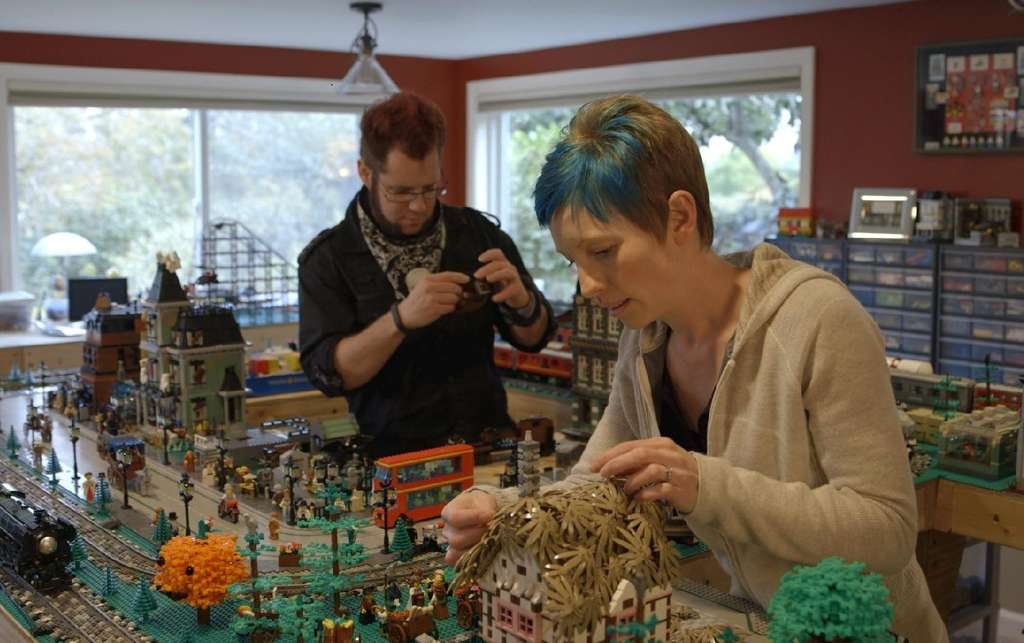 "Dave and Stacy Sterling construct a model town out of Legos in ""A Lego Brickumentary."" The toys attract children and adults alike."
