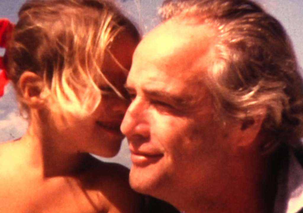 "Marlon Brando and daughter Cheyenne in an archival still from the Showtime documentary ""Listen to Me Marlon."""
