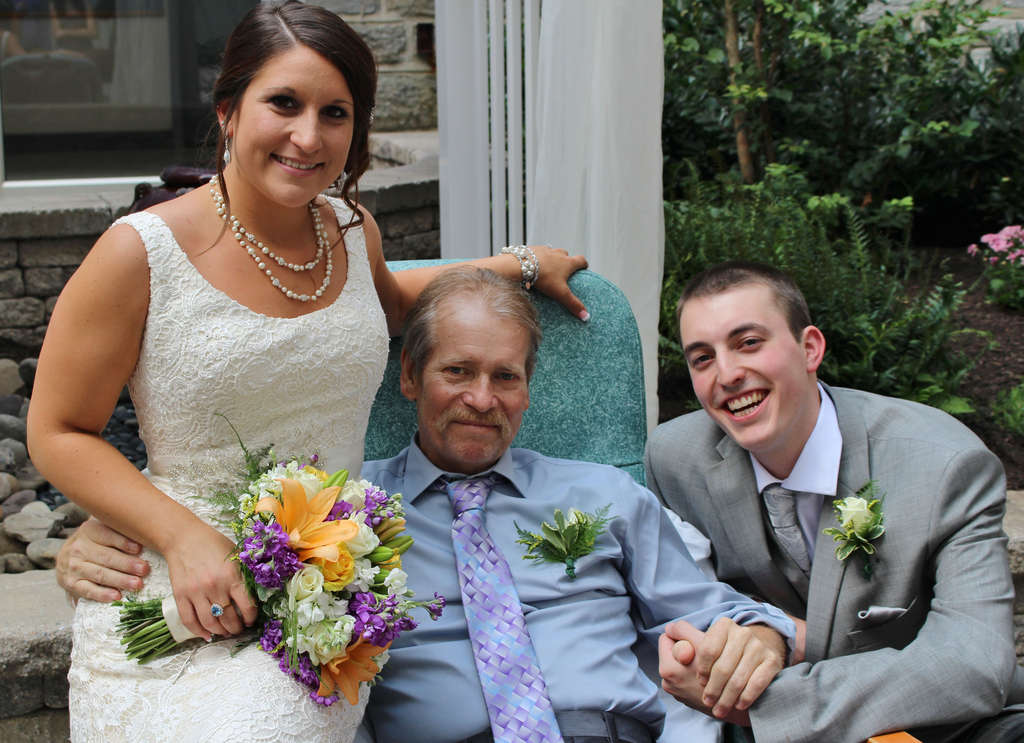 Bride Rachel Maaskant and groom Benjamin Yocum with her father, Dave, at their Jeanes Hospital wedding.