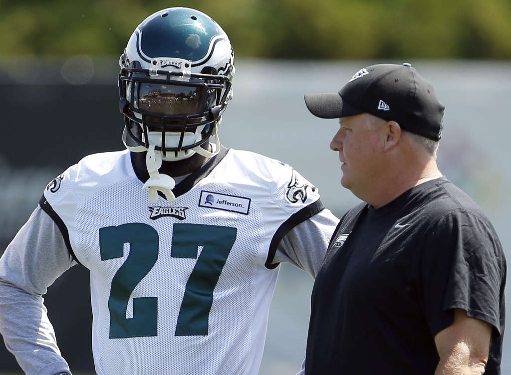 Coach Chip Kelly confers with safety Malcolm Jenkins, who could end up playing multiple roles.