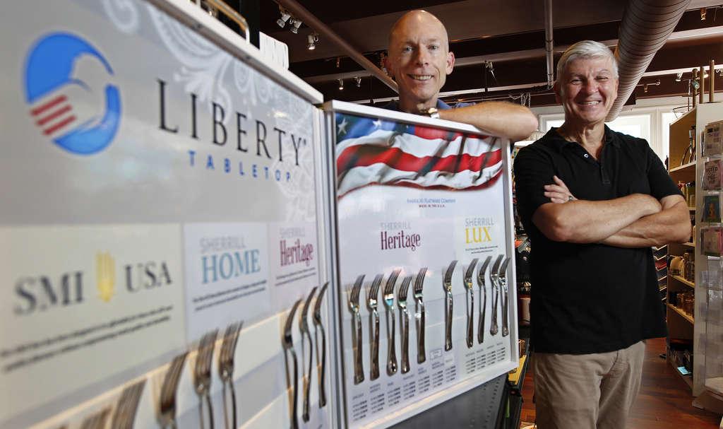 MICHAEL BRYANT / STAFF PHOTOGRAPHER Robert Hanlon (left) is one of the investors in Liberty Flatware with Bob Smith, owner of Kitchenette in Center City, which sells Liberty Tabletop, the only made-in-USA silverware.