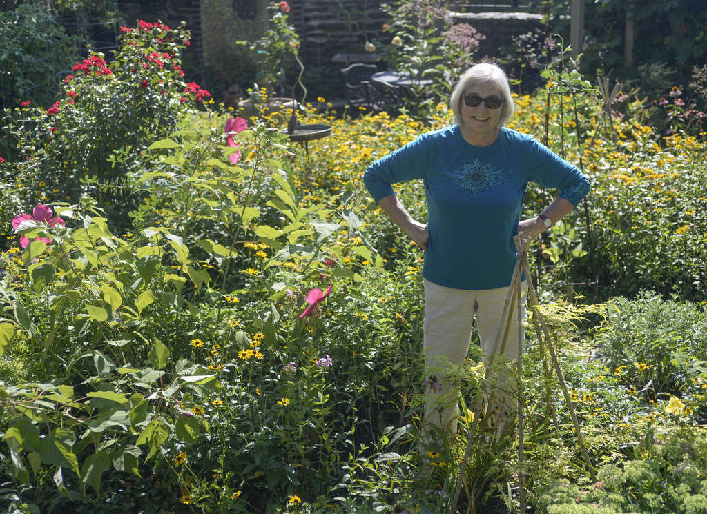 Ginny Smith in her backyard garden in East Falls, which has helped in her recovery from a debilitating lung disease. <br />