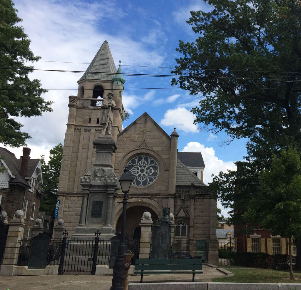 The Victorian church on Market Square in Germantown, designed by George T. Pearson in 1888, is now the Impacting Your World Christian Center.