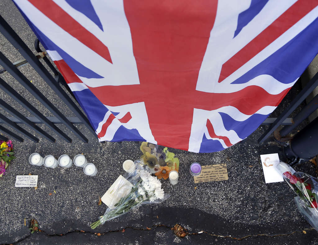 ASSOCIATED PRESS The Union Jack hangs on main gate of the Indianapolis Motor Speedway in memorial to British driver Justin Wilson.