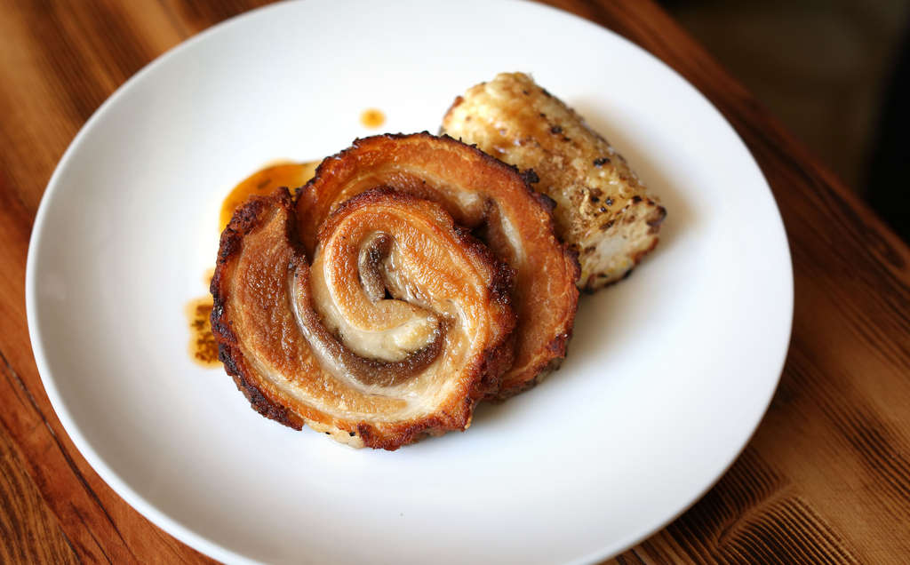 The spit-roasted pork belly at Brick & Mortar is a tender roulade finished to a crisp. (DAVID SWANSON / Staff Photographer)