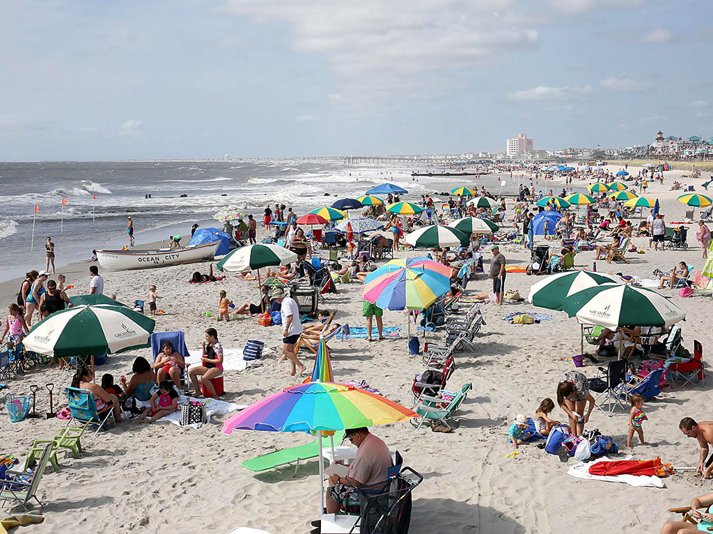 Near-perfect conditions on Saturday drew large crowds to the beaches in Ocean City, N.J. MIKE MANGER / For The Inquirer