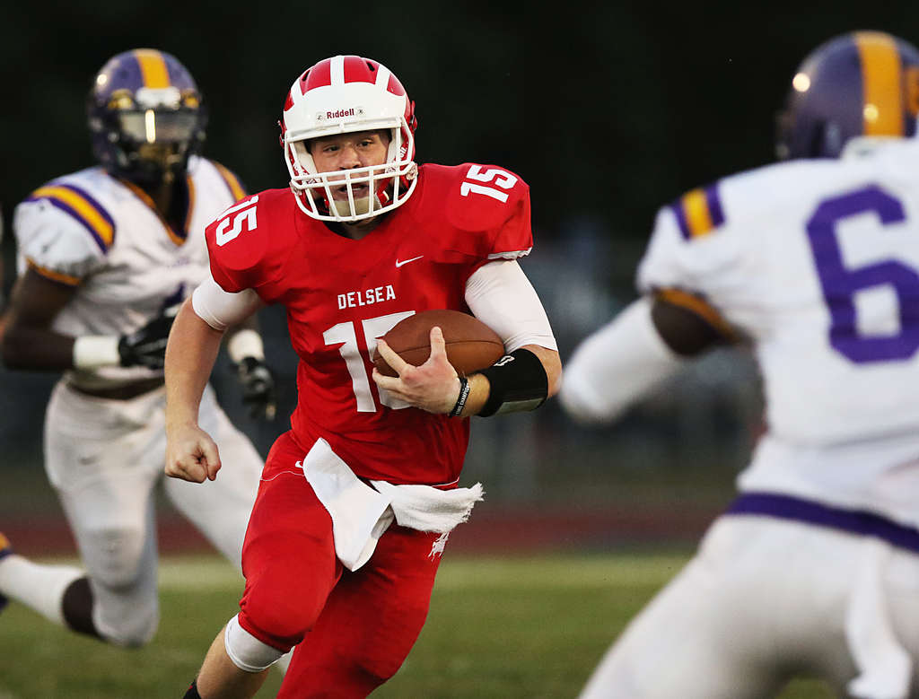 Quinn Collins of Delsea carries the ball against visiting Camden in the first quarter.The West Jersey Football League game could be a Group 3 playoff preview. AKIRA SUWA / For the Inquirer