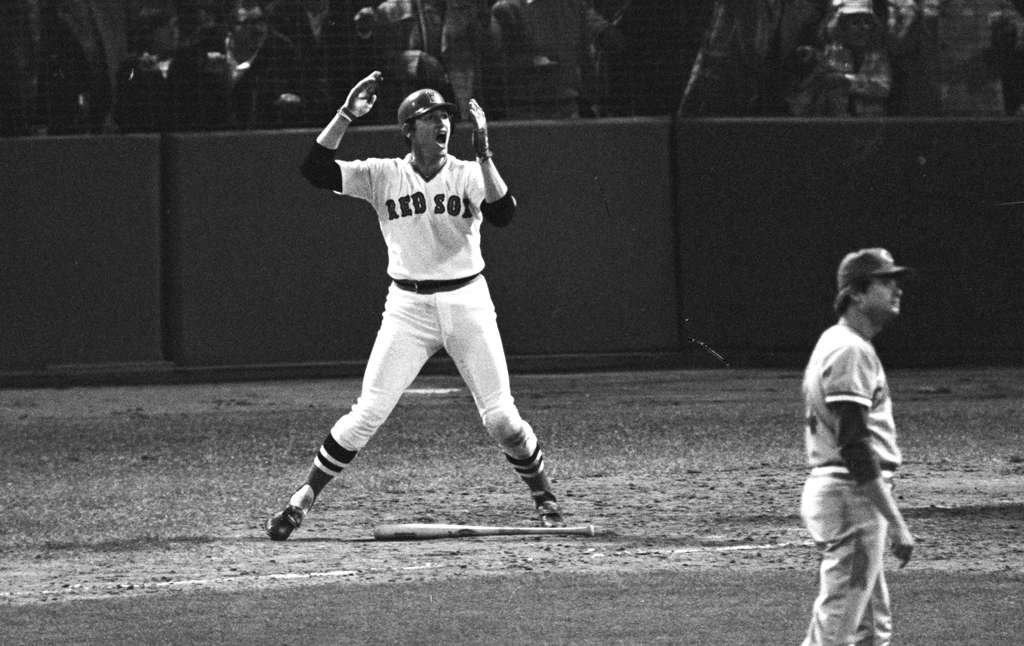 Boston´s Carlton Fisk waves as his 12th-inning home run stays fair against Cincinnati to win Game 6 of the 1975 World Series. Baseball was the most popular sport in America then, but football has passed it.